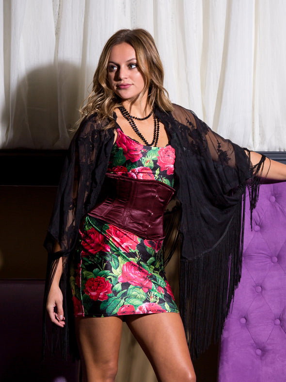 Model wearing a floral dress and our cs 301 underbust satin waspie waist training corset in wine