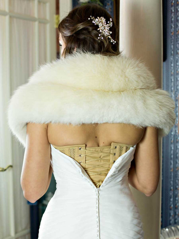model in wedding gown showing the back lace up view of a beige mesh corset with beige manufacturers laces