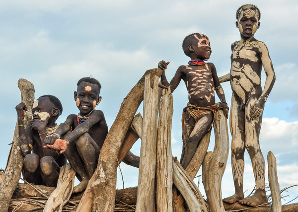 Boys on a Fence - Omo Valley - Kara Tribe