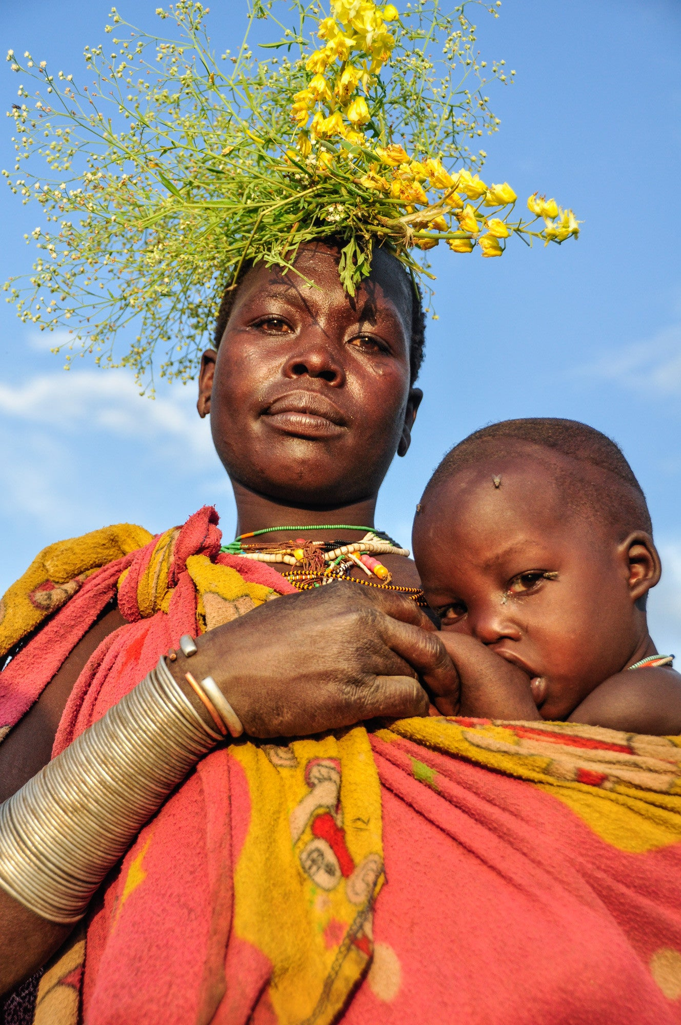 Mother with Yellow Flowers - Omo Valley - Surma Tribe