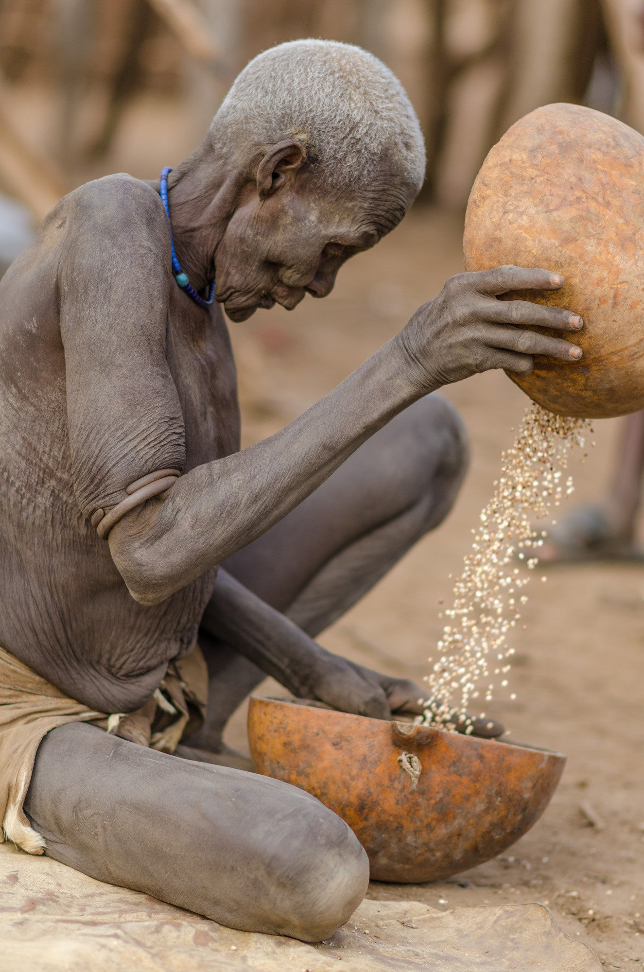 Old Lady Sifting Corn - Omo Valley - Kara Tribe