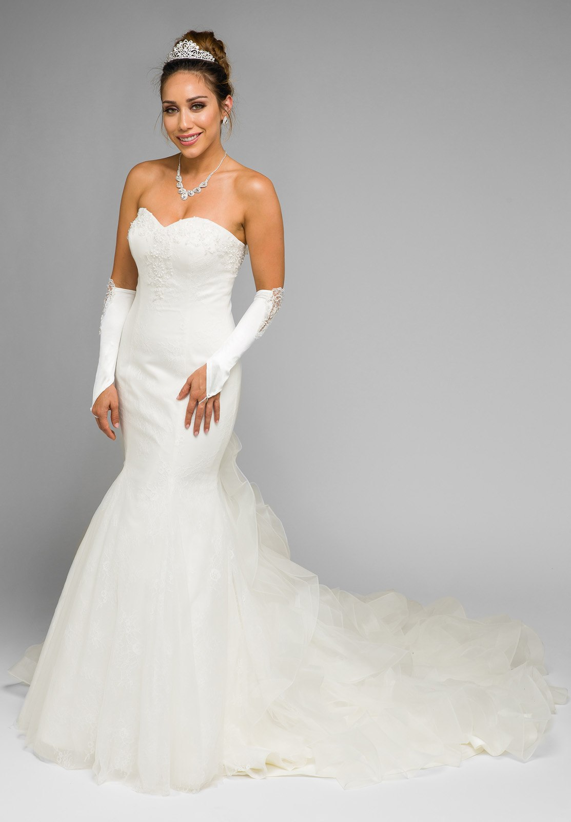 Ivory Strapless Mermaid Wedding Gown With Ruffled Chapel