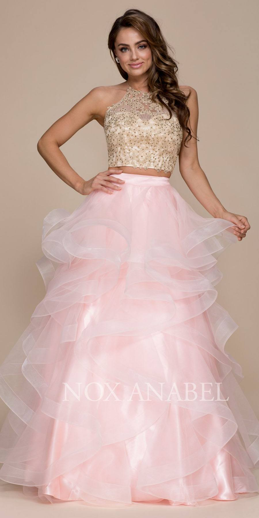 c4da79427aae Blush Gold Two-Piece Appliqued Prom Gown Ruffled Skirt. Tap to expand