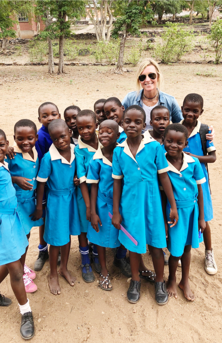 Becky in Zimbabwe with local school children