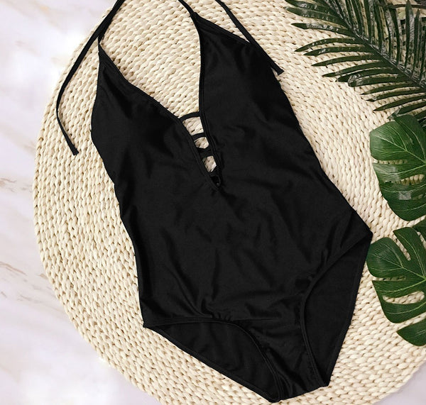 THE LITTLE BLACK ONE PIECE