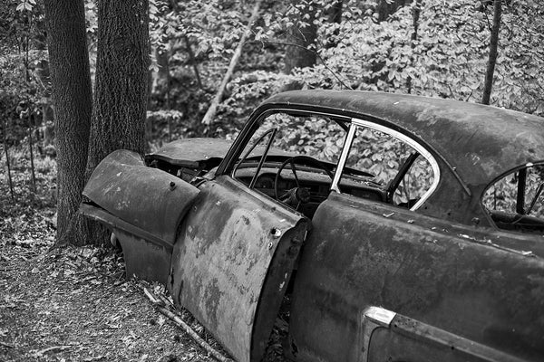 The story behind a very old wrecked car found in the forest