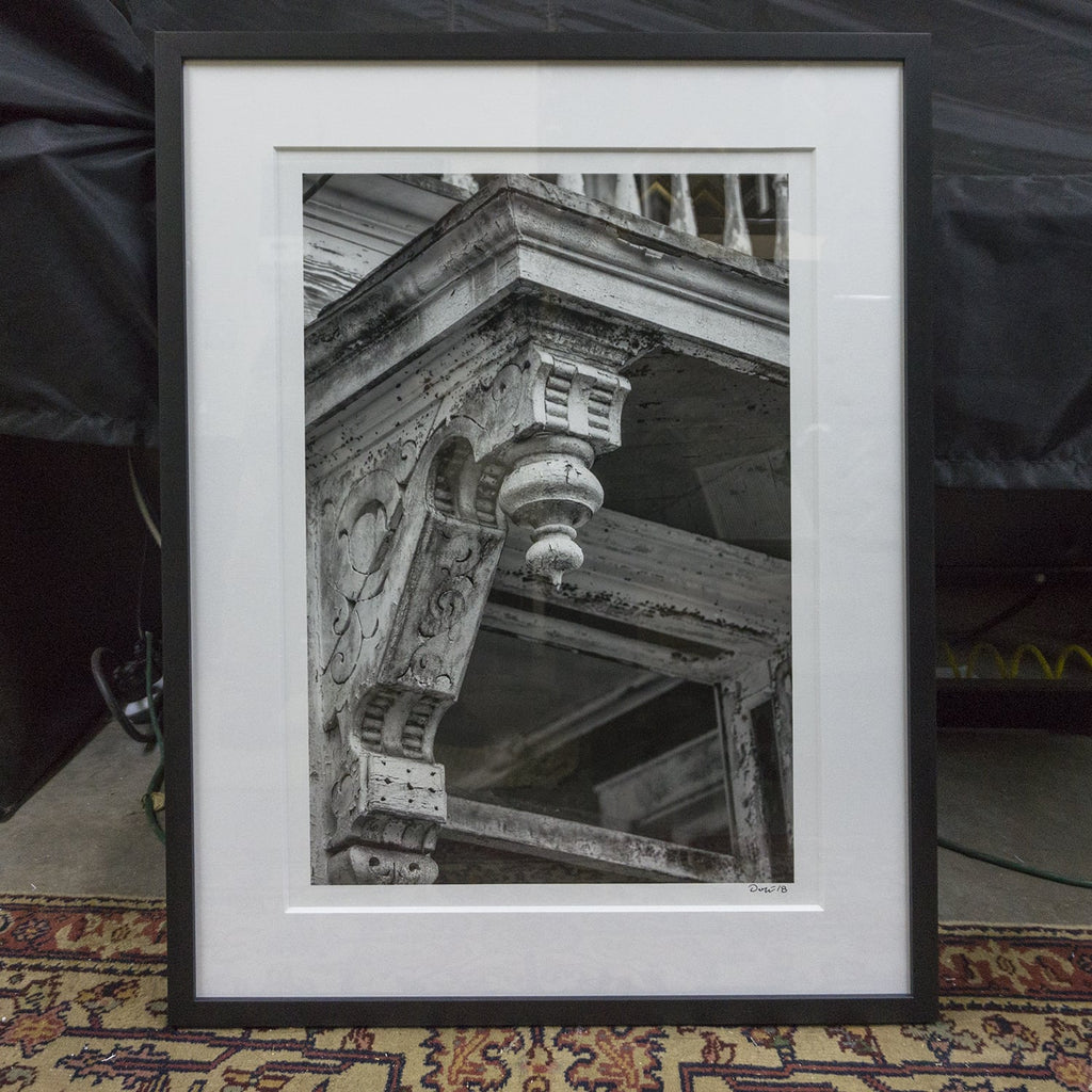 Six black and white photographs of Charleston professionally framed
