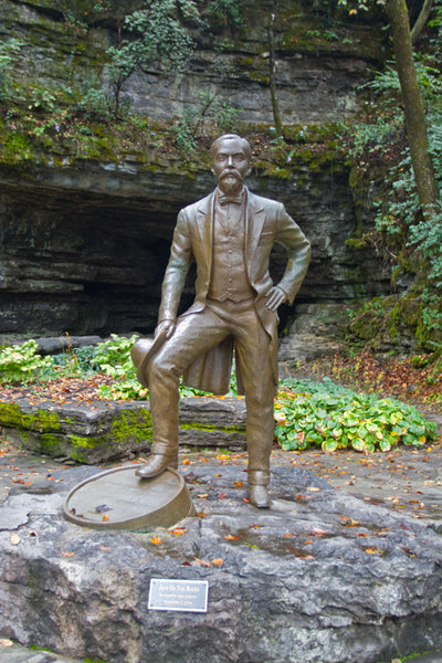 Statue of Jack Daniel on the grounds of the historic distillery in Lynchburg, Tennessee