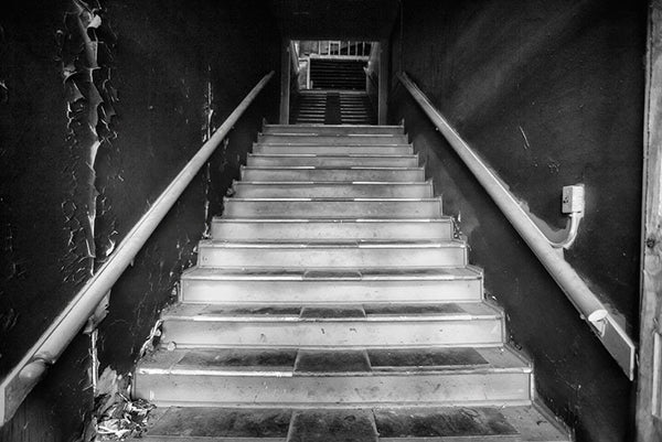 Main stairwell inside an abandoned office building