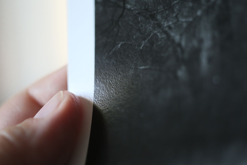 A close-up look at the surface of a real darkroom-style silver gelatin baryta-coated fiber paper