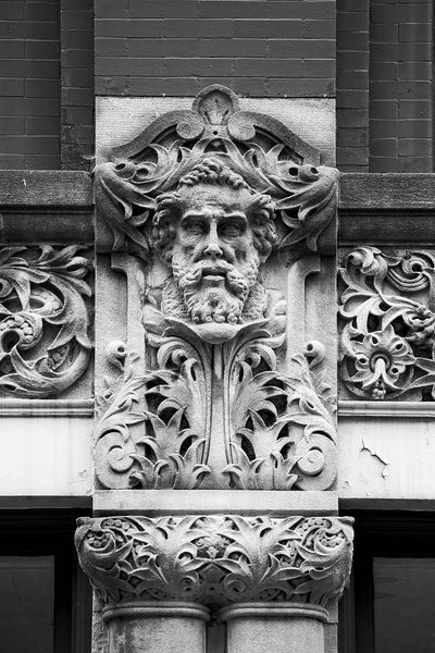 Carved Face of a Bearded Man on the Drhumor Building in Asheville. Click to buy a fine art print.