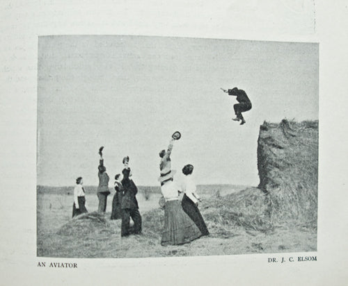 Well-dressed pre-WWI Wisconsinites leaping from large haystacks, just for fun.