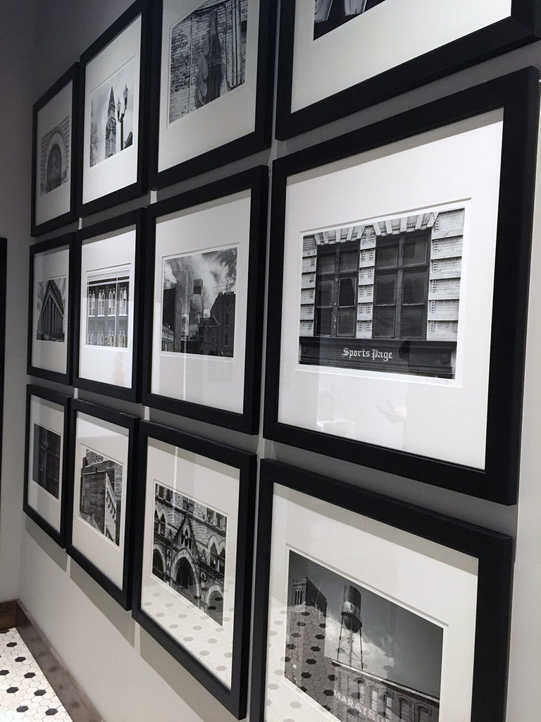 Interior photograph of Char Restaurant Nashville showing a gallery wall of photographs by Keith Dotson. Photograph by Sandy Burr.