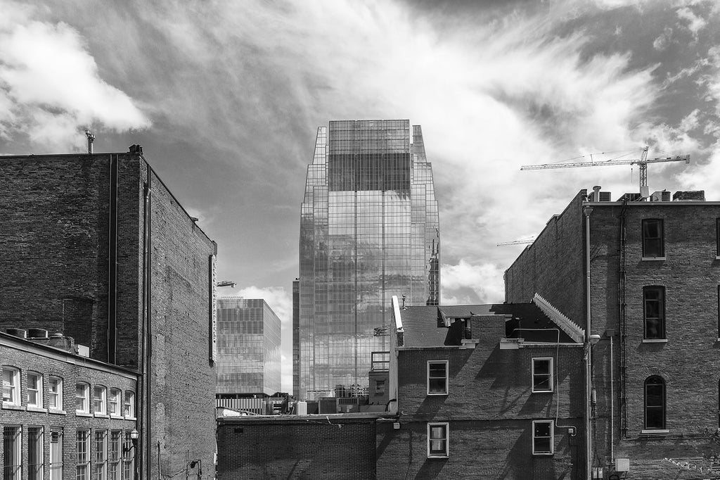 View of the Pinnacle Building with Clouds and Construction Cranes, Nashville. Buy a fine art print.