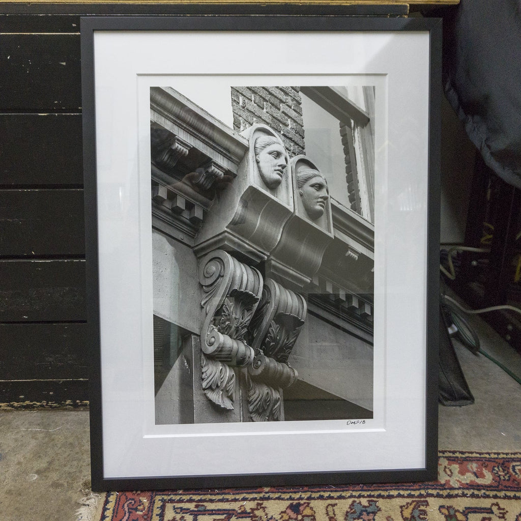 Framed black and white photograph, 'The Ladies of Meeting Street,' by Keith Dotson, framed by Blue Door Framing in Nashville.