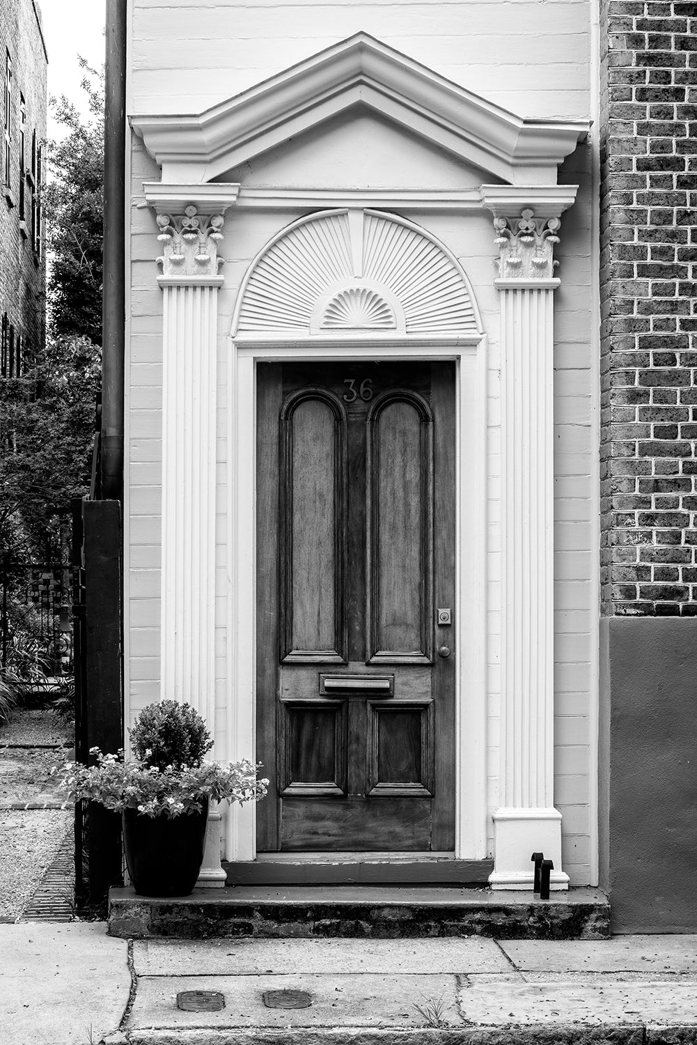 Charleston Door with Clamshell Pediment - Black and White Photograph by Keith Dotson. Buy a fine art print.
