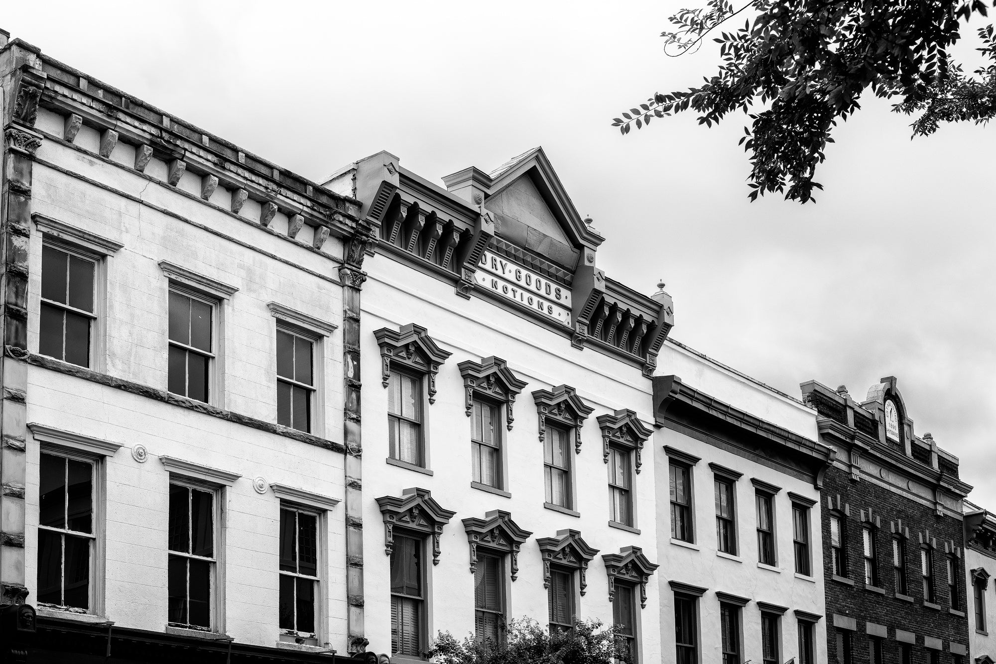 Charleston Meeting Street Historic Storefronts - Black and White Photograph by Keith Dotson. Buy a fine art print.