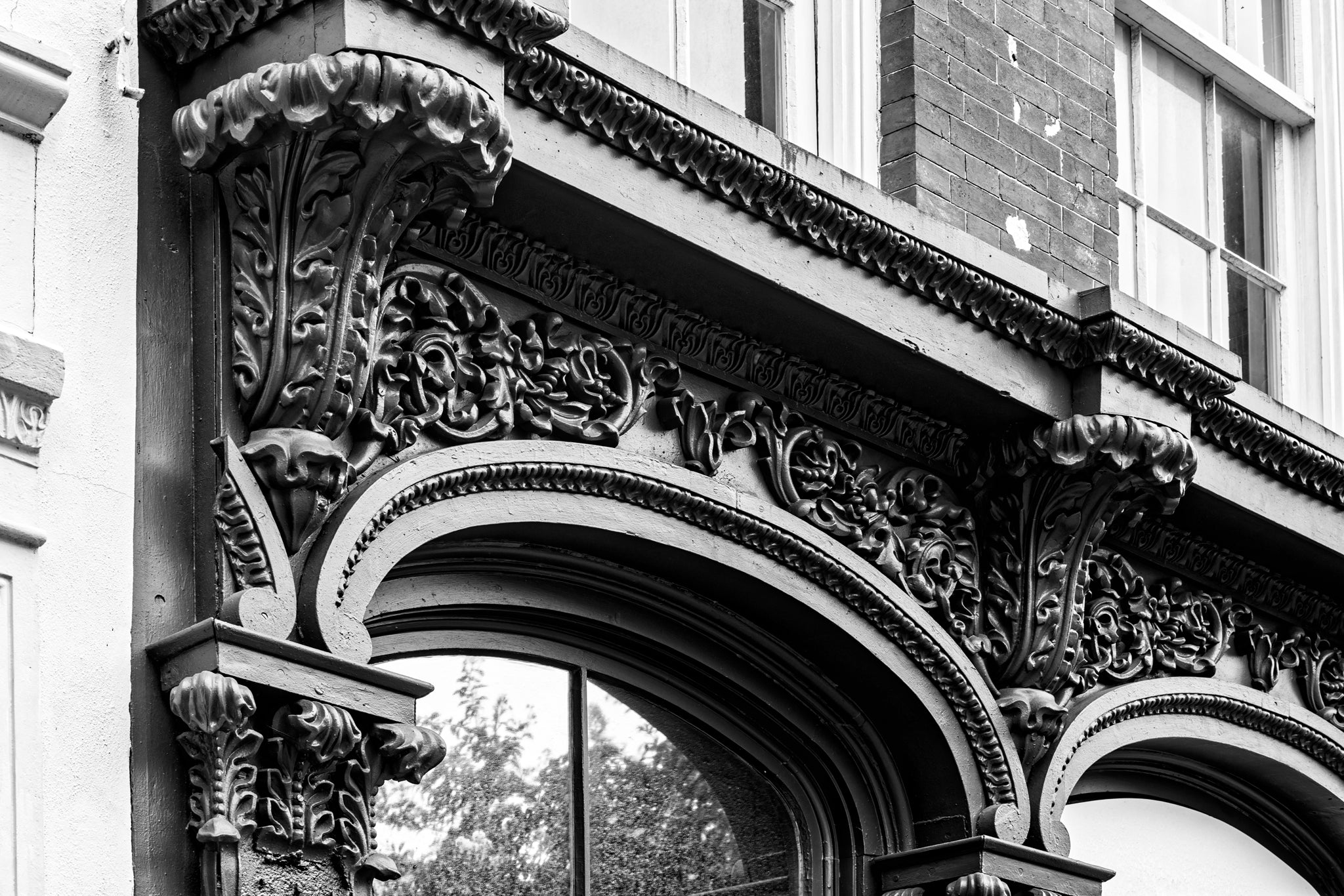 Ornate Iron Storefront Charleston - Black and White Photograph by Keith Dotson. Buy a fine art print.