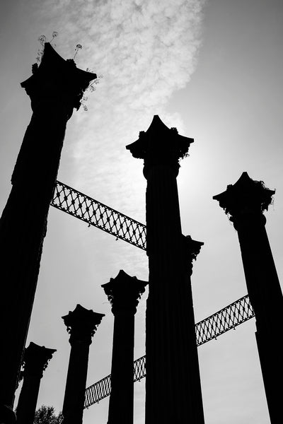 Columns at Windsor Ruins Silhouetted Against the Sun, black and white photograph by Keith Dotson.