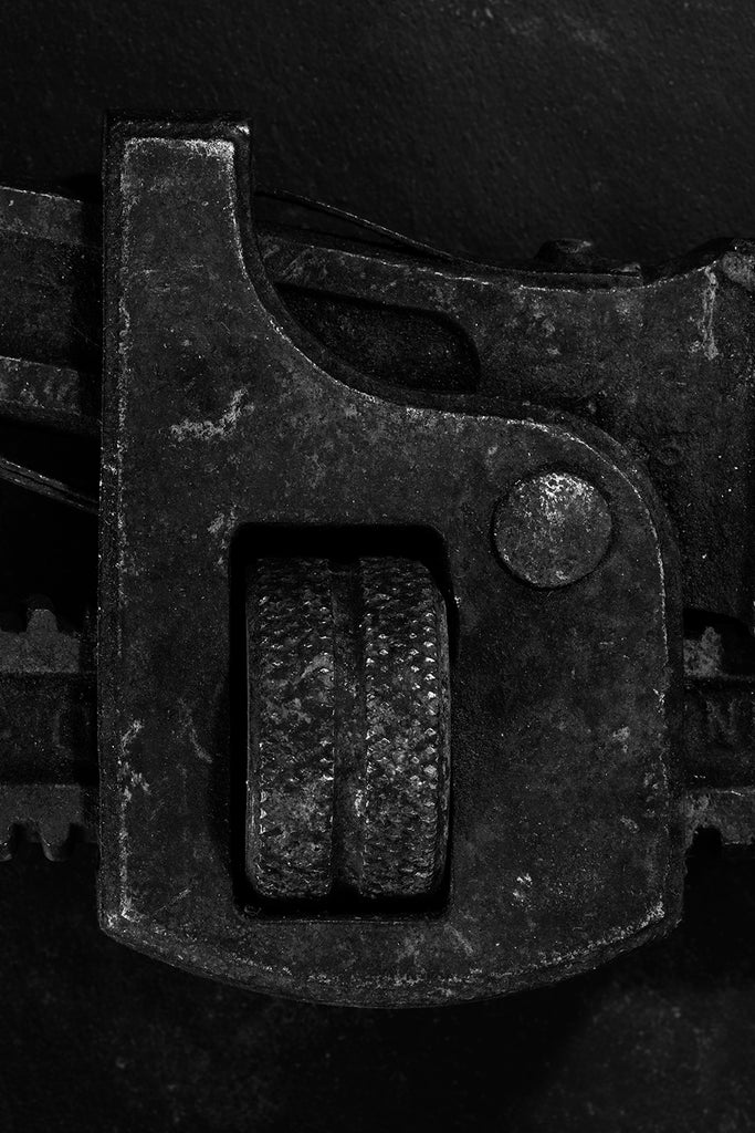Abstract detail photograph of a rusty antique wrench, black and white photograph by Keith Dotson.