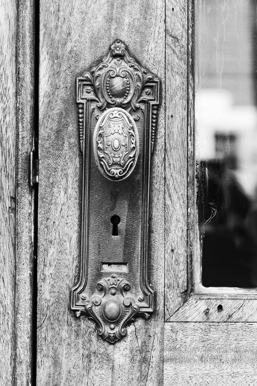 Black and white photograph of a beautifully decorative old door knob on an office building in a small city in the American South. Fine art print available here.