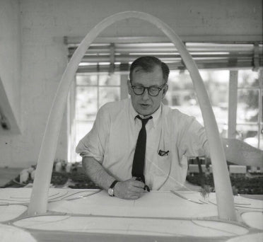 """Eero Saarinen with Gateway Arch Model"" by Saarinen, Eero, Collection Manuscripts & Archives, Yale University (1957)."