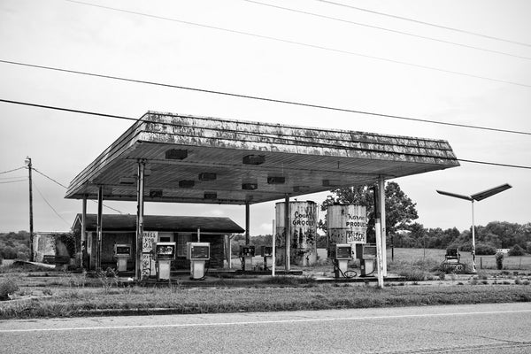 Abandoned gas station, a black and white photograph by Keith Dotson.