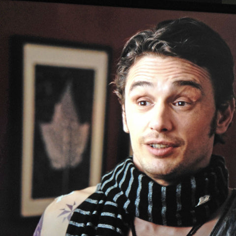 "Actor James Franco with one of Keith's leaf photographs over shoulder in a scene from the movie ""Why Him?""."