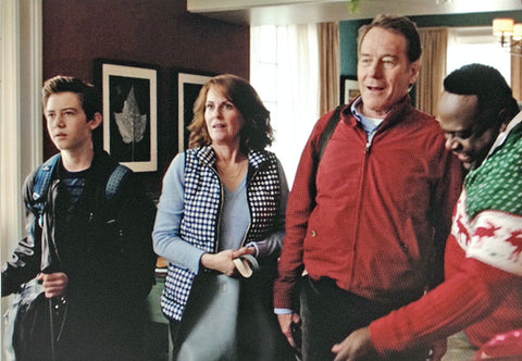 "Some of the cast of ""Why Him?"" on the set with two photographs by Keith Dotson. Pictured here are Griffin Gluck, Megan Mullally, Bryan Cranston, and Cedric the Entertainer."