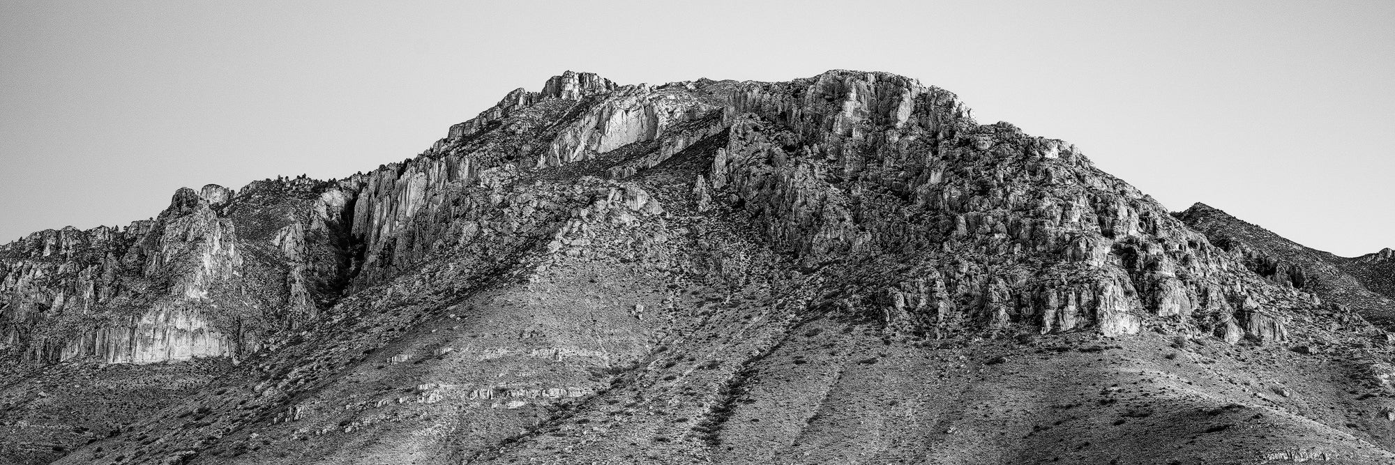 Guadalupe Mountains, a back and white panoramic photograph by Keith Dotson.