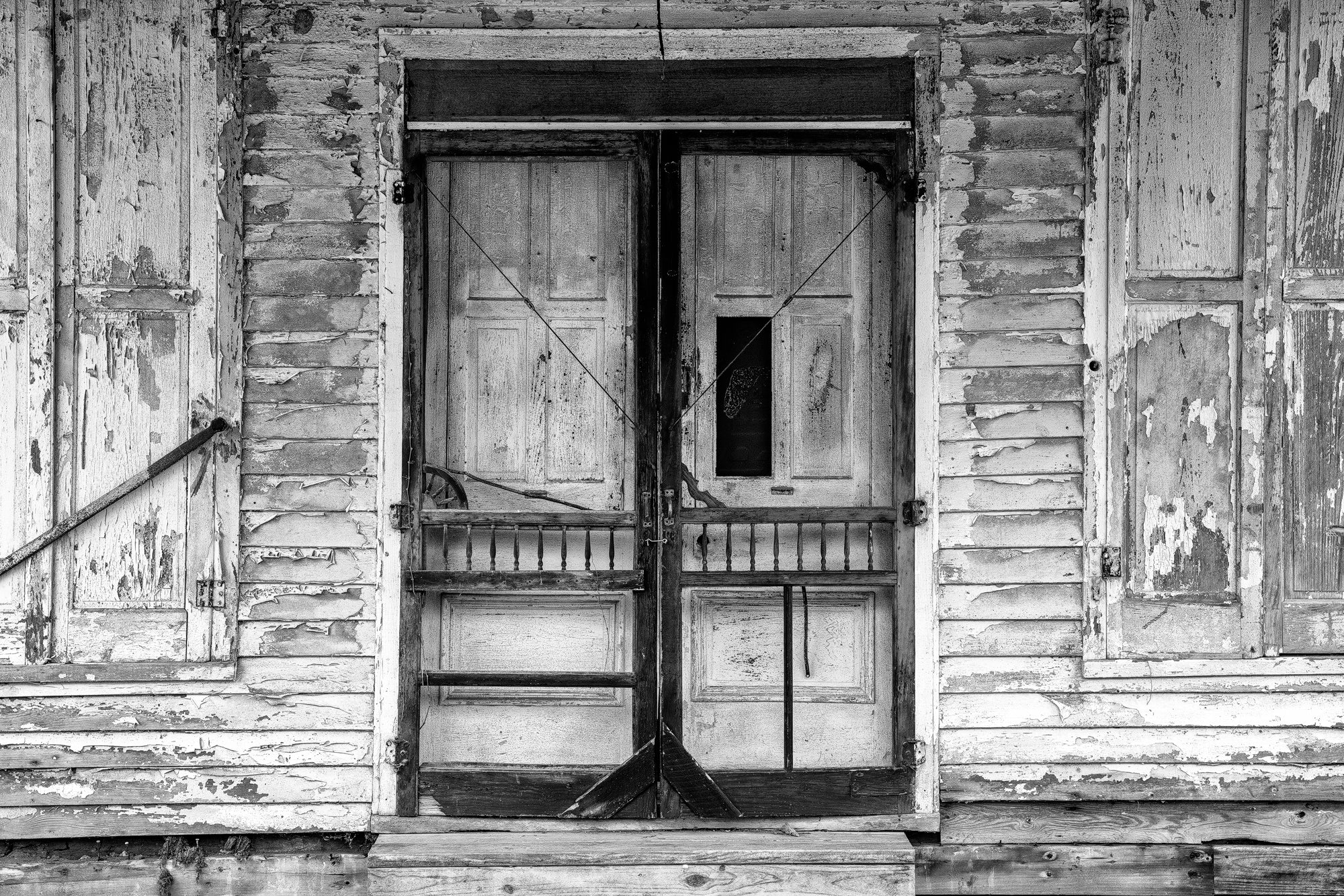 Tattered Screen Doors on an Abandoned Country Store: Black and White Photograph by Keith Dotson. Buy a fine art print here.