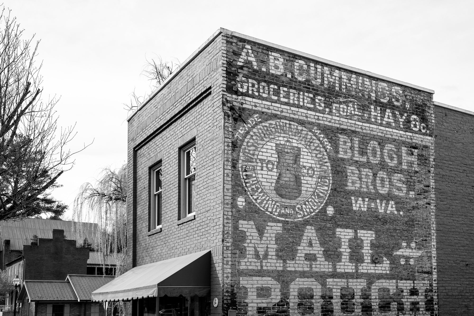 Black and white photograph of the historic Mail Pouch ghost sign in Jonesborough, Tennessee