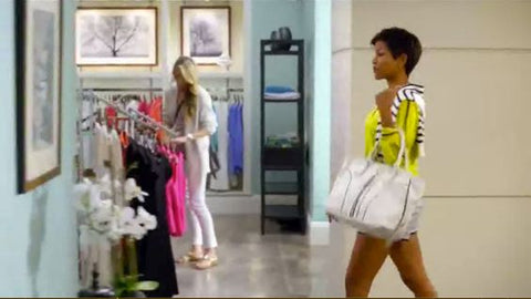 Photographs by Keith Dotson can be seen on the far back wall, in this TV commercial for US apparel retailer Marshall's