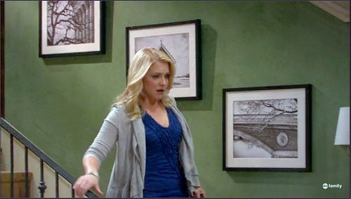 Melissa Joan Hart seen with three Keith Dotson photographs on the set of Melissa and Joey (ABCFamily)