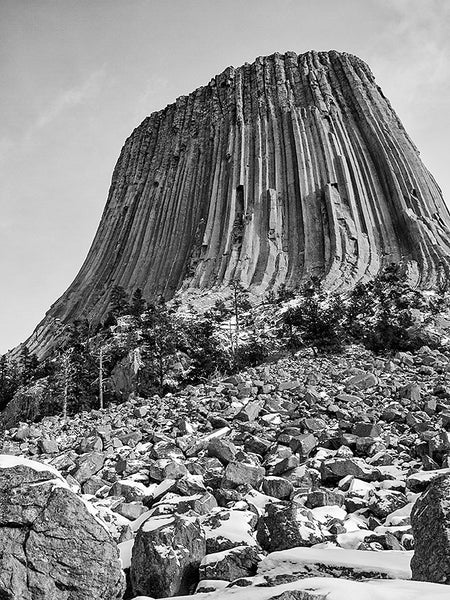 View of Devil's Tower Wyoming from Below, a black and white landscape photograph by Keith Dotson. Click to buy a print.