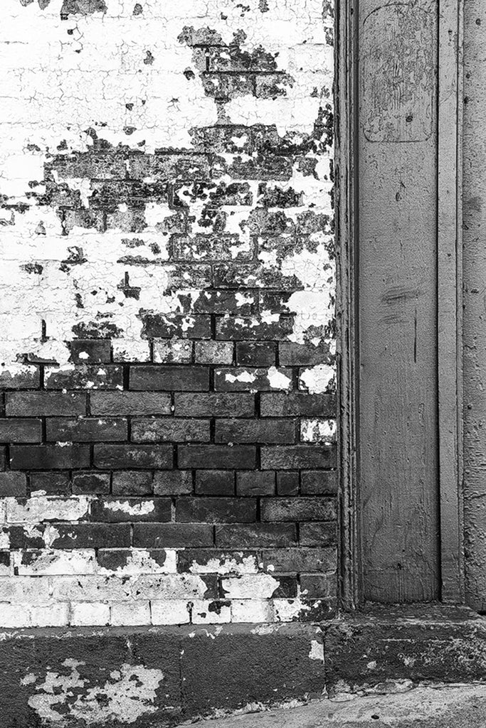 Exterior brick detail of the old Acme Farm Supply Building, black and white photo by Keith Dotson.