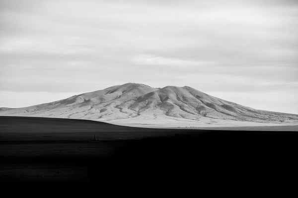White Mountain / Black Shadows in New Mexico, a black and white landscape photograph by Keith Dotson. Buy a print.