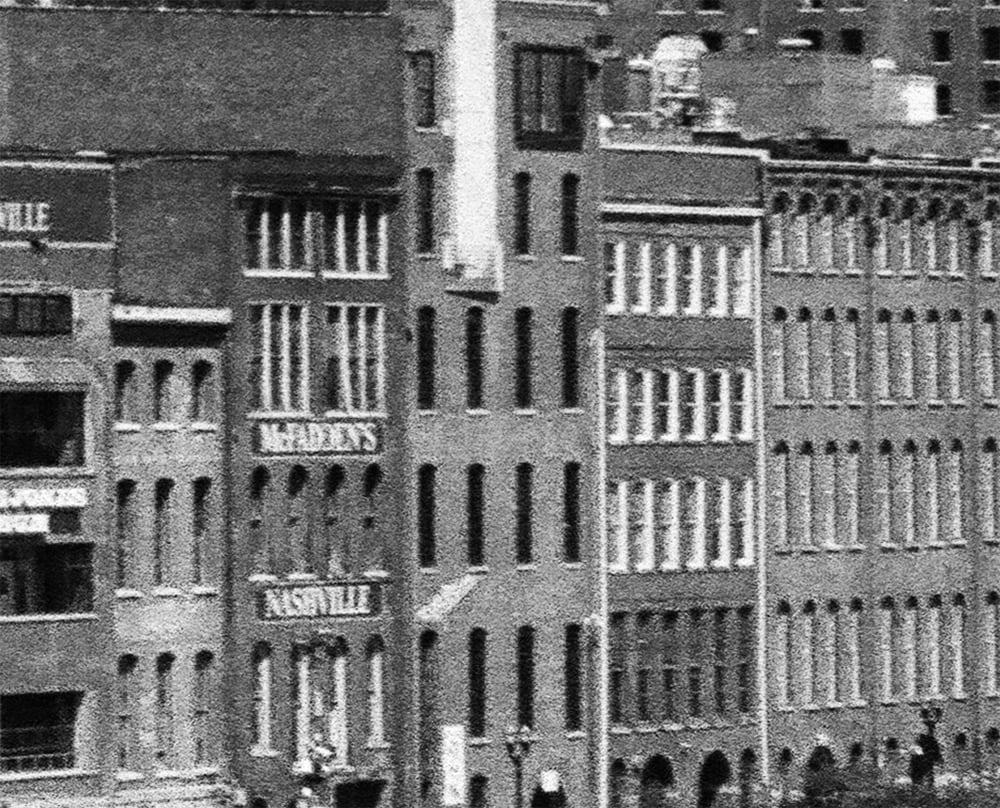 Highly magnified section of the Nashville skyline shown above. This illustrates the film grain of the Ilford Delta 400 film.
