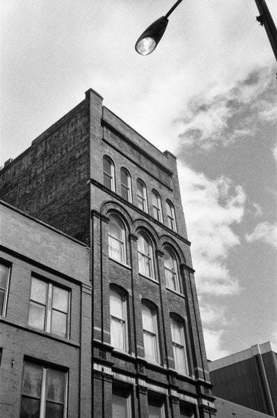Black and white photograph of a historic circa 1900 Nashville office building with a faded ghost sign for the long-gone Bradford Nichol Furniture, which was open for business by at least 1870 at 25 and 27 North College Street in Nashville, according to a listing in The Masonic Record, published that year.