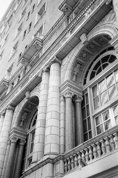 Black and white photograph of the front of the historic Hermitage Hotel in Nashville.   This photograph was shot on 35mm Ilford Delta 400 black and white film. Note that your print will contain the characteristic film grain evident in film stock, which most people consider a desirable effect of analog film photography.