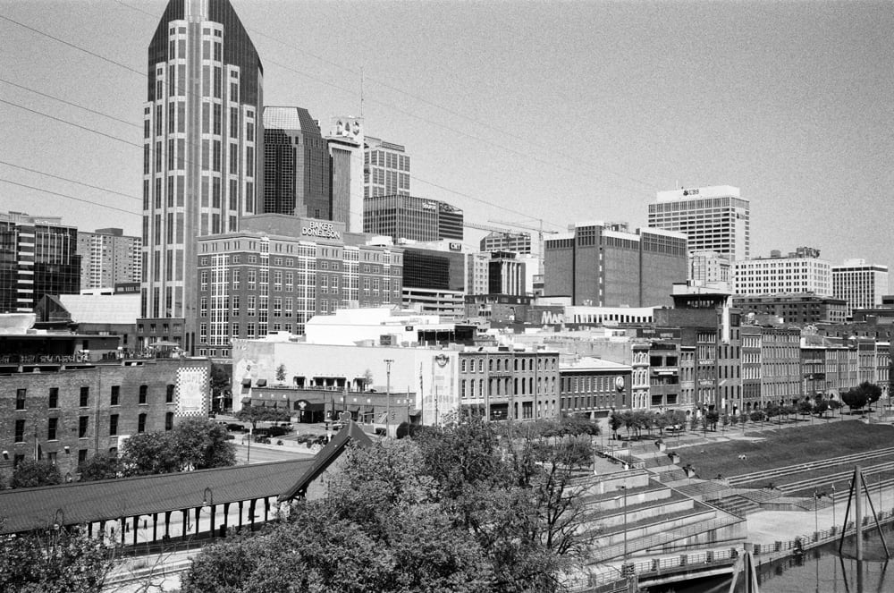Black and white photograph of downtown Nashville, as seen from the John Seigenthaler Pedestrian Bridge (formerly known as the Shelby Street Pedestrian Bridge)