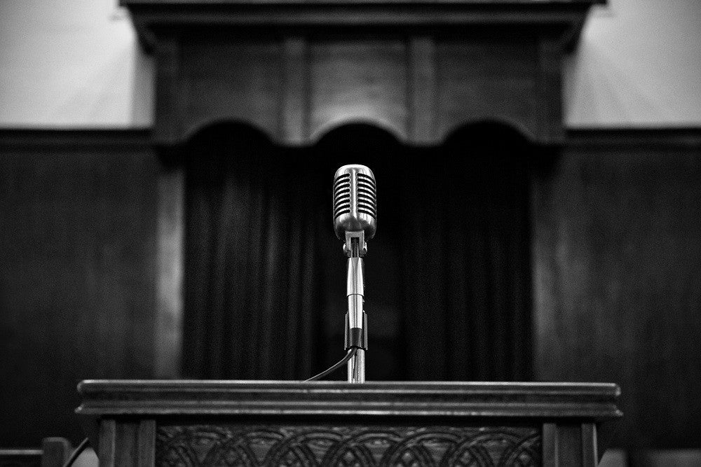 Black and white photograph of Martin Luther King's pulpit and microphone at Ebenezer Baptist Church in Altanta.