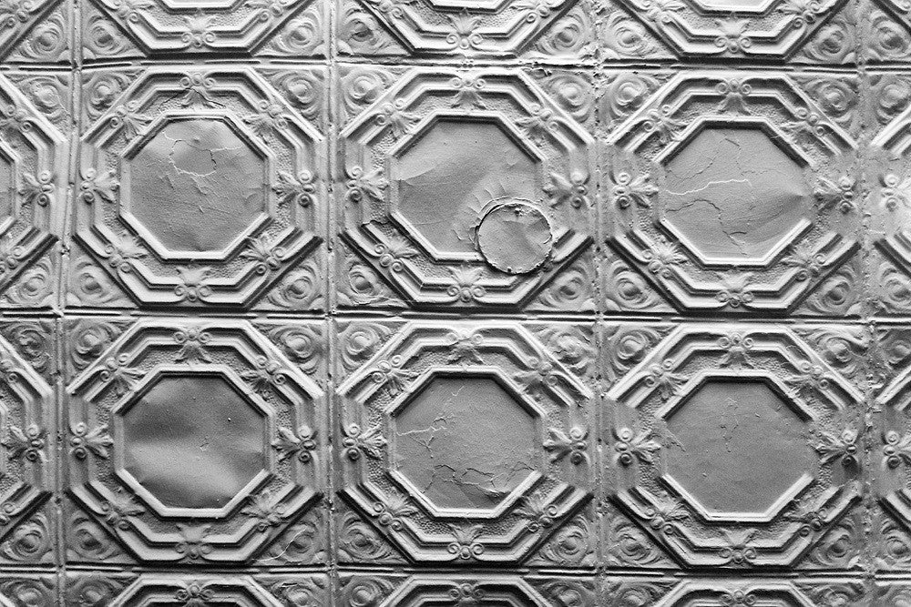 Black and white photograph of the pressed tin ceiling inside Ebenezer Baptist Church in Atlanta, where Martin Luther King gave sermons.