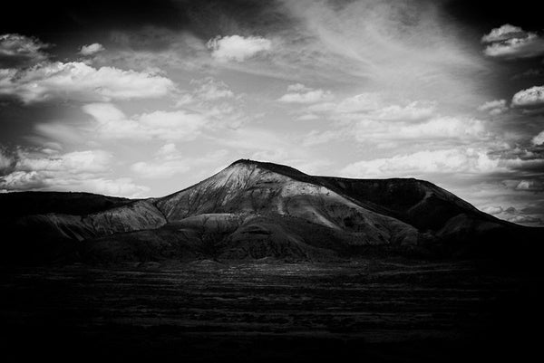 Black and white fine art landscape photograph of a mountain in late day shadows, near Gunnison, Colorado.