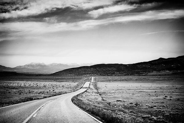 Black and white fine art landscape photograph of Colorado Highway 69 heading west toward the Rocky Mountains.