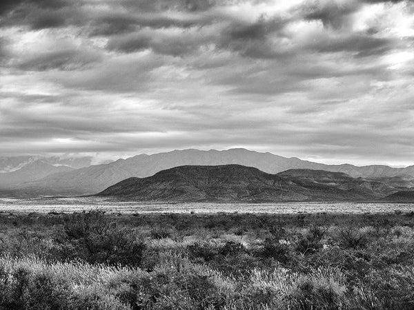 Black and white landscape photograph of the Sacramento Mountains on a stormy day in New Mexico.