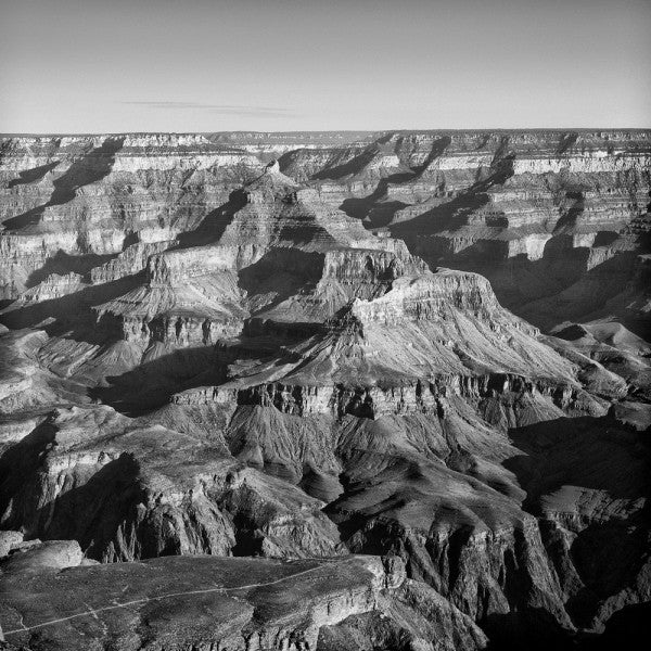 Black and white landscape photograph of the Grand Canyon, seen from the South Rim. Square format.