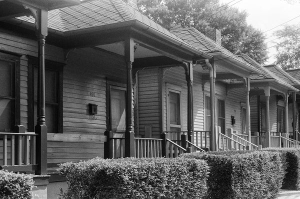 Black and white photograph of a row of shotgun houses across the street from Dr. Martin Luther King's birthplace in the Sweet Auburn neighborhood of Atlanta, Georgia.