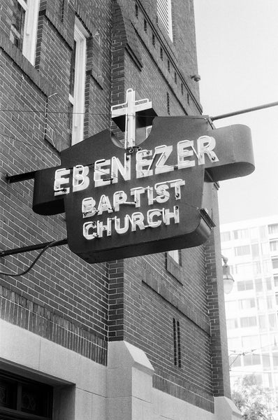 Black and white photograph of the vintage sign on the front of Dr. Martin Luther King, Jr.'s historic Ebenezer Baptist Church in Atlanta.