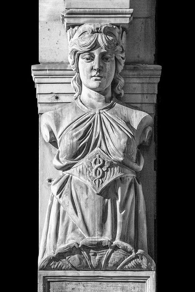 Black and white photograph of a Victorian era female sculpture on a historic building in downtown Paducah, Kentucky. This figurative architectural representation of a carved female figure is reminiscent of the famous Greek caryatids on the Parthenon in Athens.